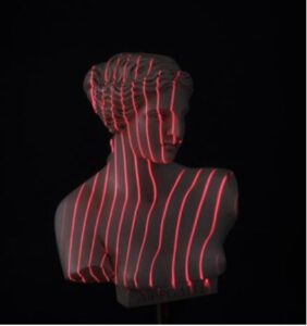 Multi-line laser projection on statue