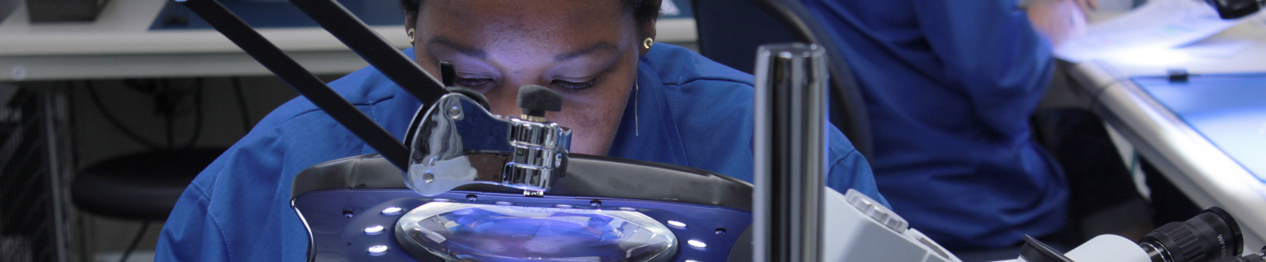 Osela employee working on Lasers for Machine vision and Bioinstrumentation